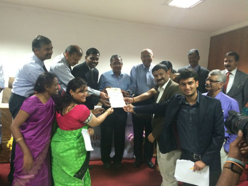 EWB-Bengaluru Chapter Certificate being issued by Dr.Kota Harinarayana & Dr.Ashok Agarwal